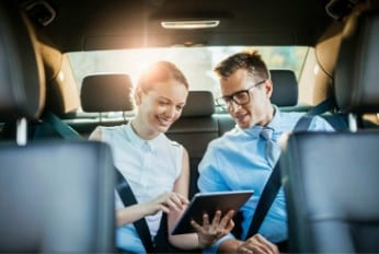 Business People Working in back of Our Executive Chauffeur Driven Car Service in Derby